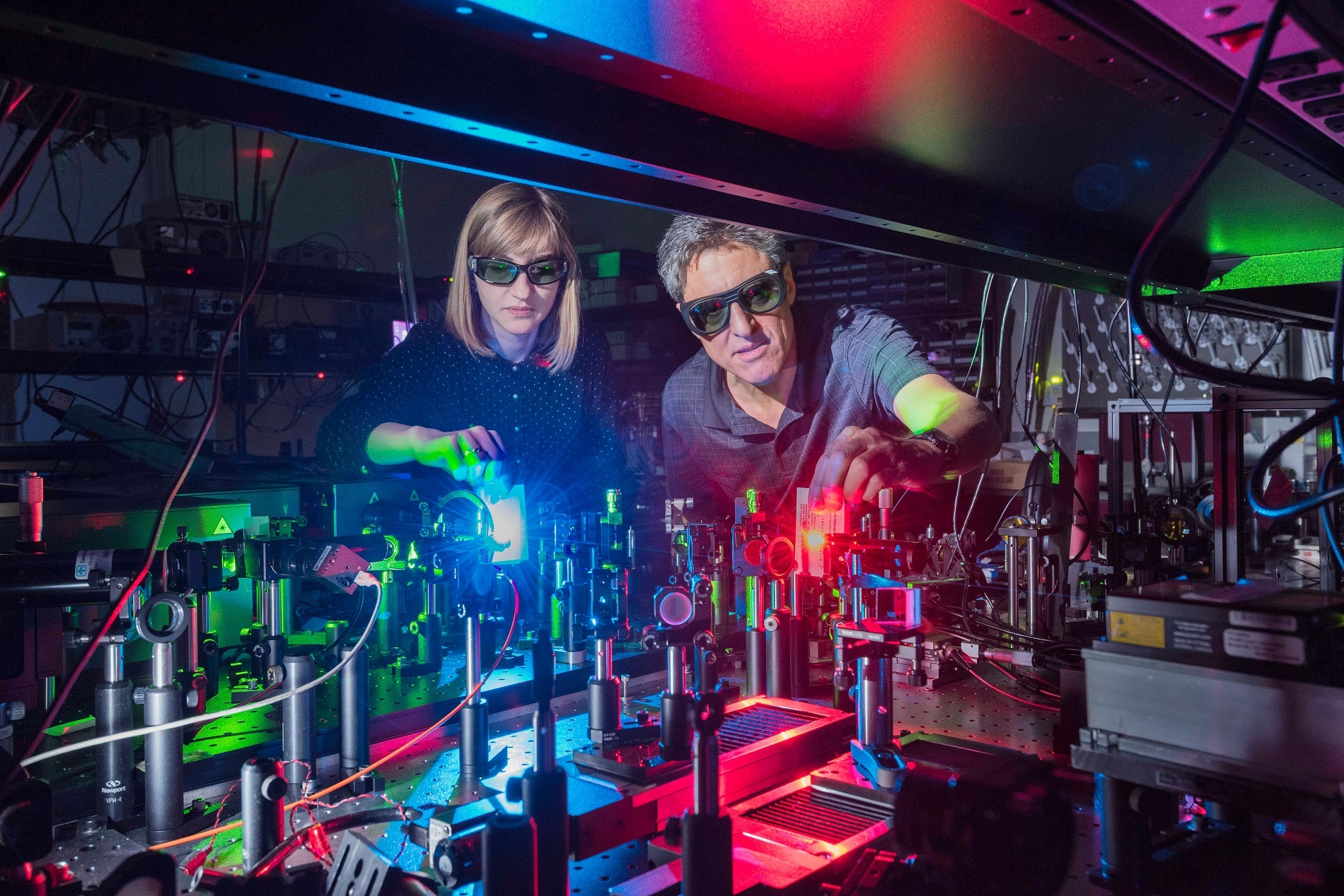 Sandia National Laboratories postdoctoral appointee Polina Vabishchevich, left; and Senior Scientist Igal Brener made a metamaterial that mixes two lasers to produce 11 colors ranging from the near infrared, through the colors of the rainbow, to ultraviolet