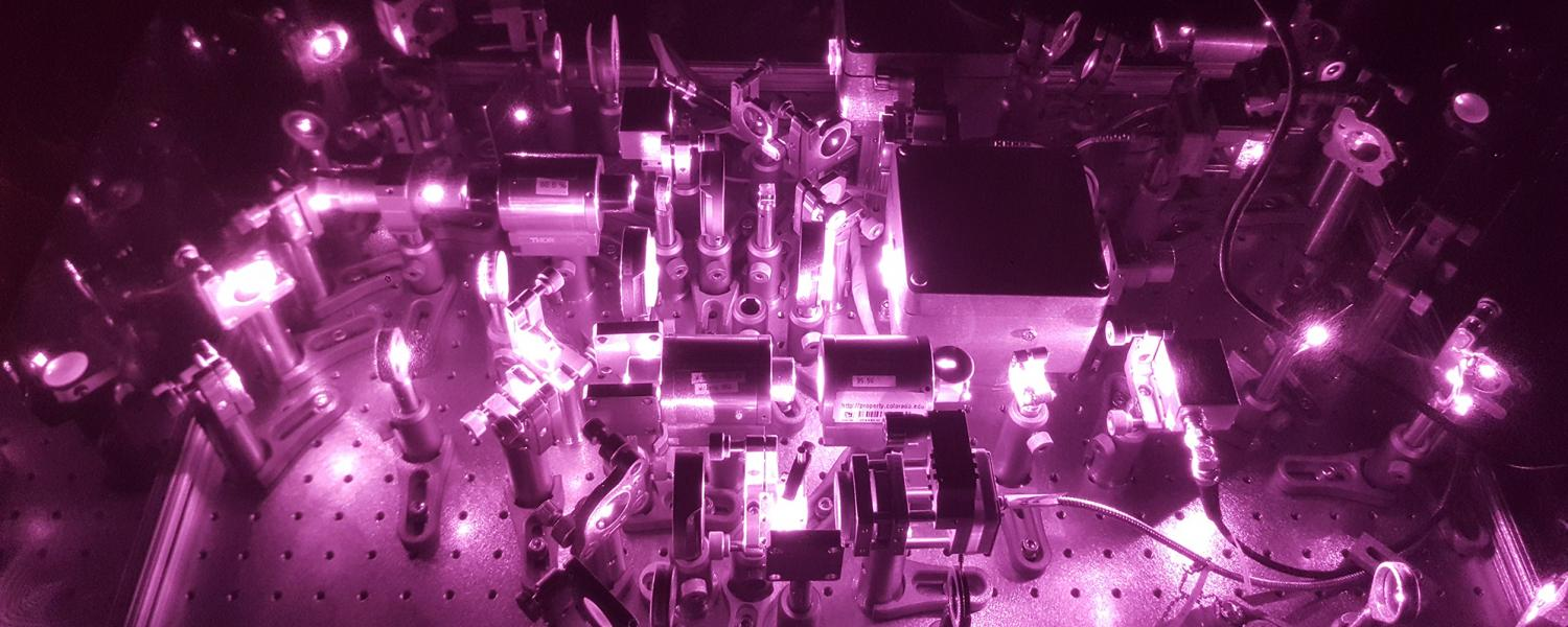 A photograph of an infrared optical tweezers device. Normally, the light from such lasers would be invisible to the naked eye.