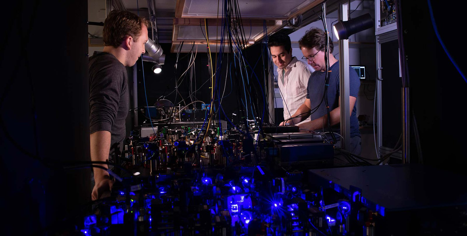 Adam Shaw, Ivaylo Madjarov and Manuel Endres work on their laser-based apparatus at Caltech