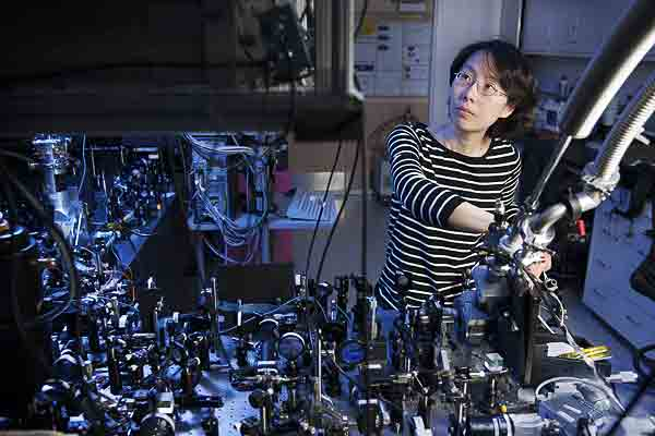 Physicist Na Young Kim, at the optical bench