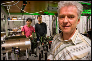 Professor Eugene Polzik in the quantum optics laboratory with the experiment setup in the background
