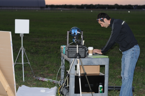 Joseph Meola of Air Force Research Labs conducting measurements on laser light bounced back from various samples placed 1.6 kilometers