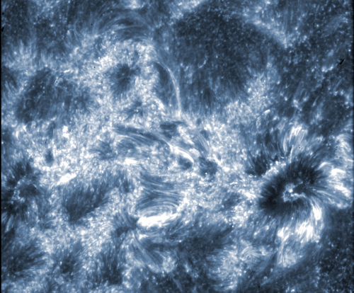 This image from NASA's IRIS spacecraft shows the region around two sunspots