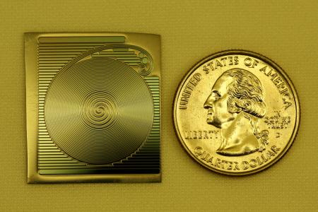 A photograph of the spiral chip-based optical resonator