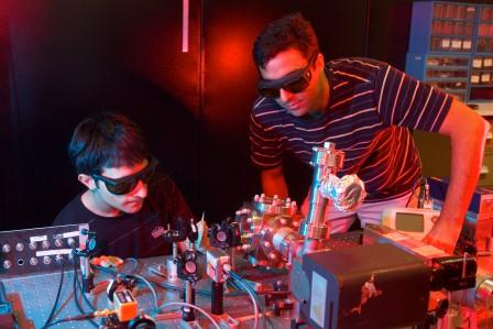 Dr Mahdi Hosseini and Mr Giovanni Guccione working on their opto-mechanical laser system