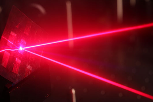 A laser being used to understand why plastic solar cells are efficient