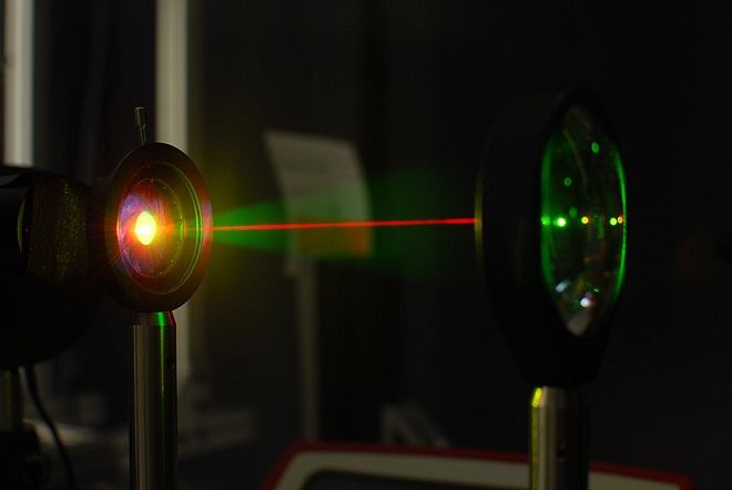 A laser beam is used in the lab to test the gold-hyperdoped sample of silicon to confirm its infrared-sensitive properties