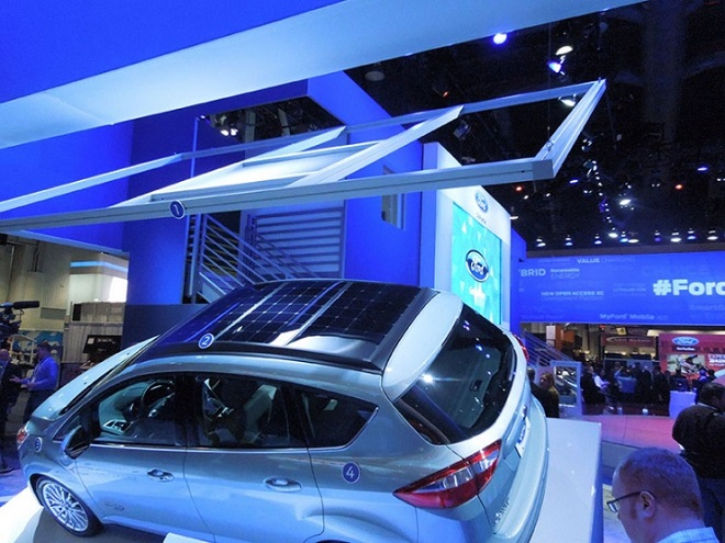 A model of the solar concentrator hangs above the C-MAX Solar Energi Concept