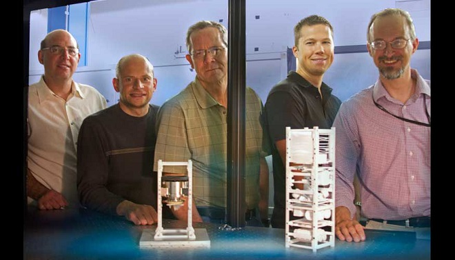 Brian Bauman, Vincent Riot, Darrell Carter, Lance Simms and Wim De Vries have developed and tested land-based mini-satellites that eventually will be used in space to help control traffic in space