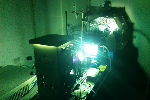 A powerful arc lamp is used to simulate sunlight on a sample of photoswitchable molecules, driving structural changes at the molecular level