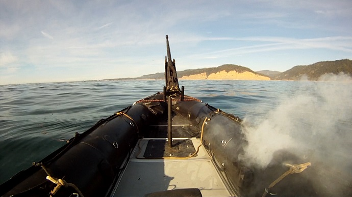 In tests off the California coast, the Lockheed Martin ADAM laser system burns through the hull of a military-grade boat