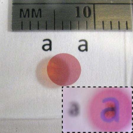 Photo of a high contrast transmitarray lens designed for red light