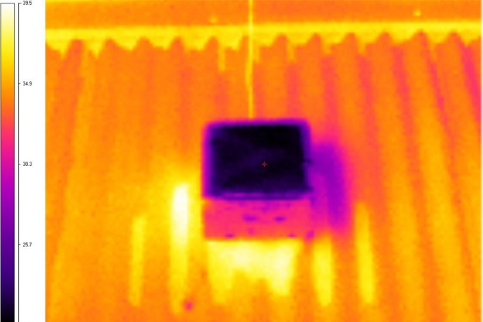 An infrared image showing the temperature difference between the new surface and an existing cool roof used in testing