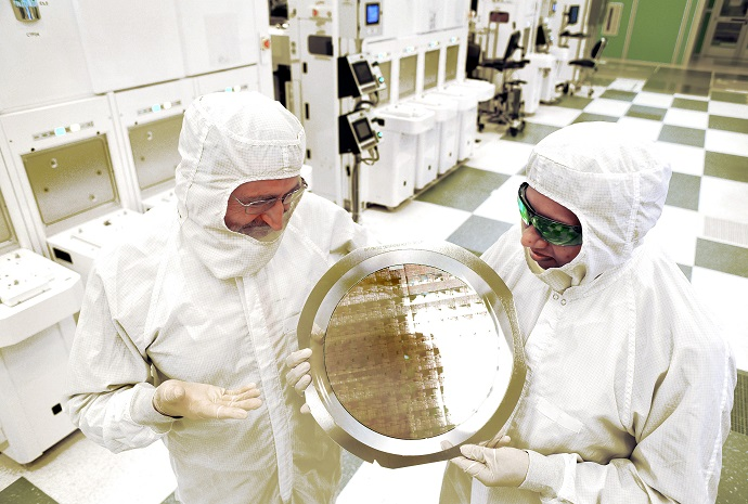 Researchers inspect a wafer comprised of 7nm node test chips in a clean room in Albany