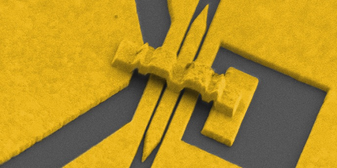 Colourized electron microscope image of a micro-modulator made of gold