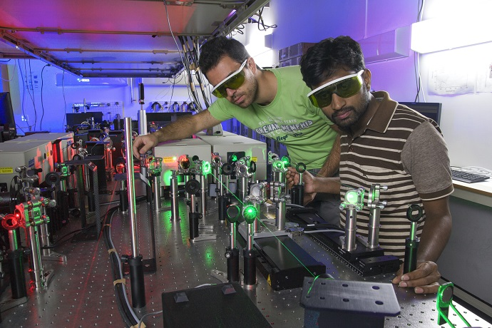 Researchers perform an experiment in Femtosecond laser laboratory