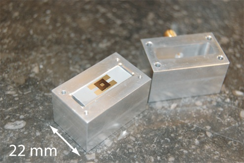A quantum microwave oven for cooling the motion of a millimeter sized vibration membrane