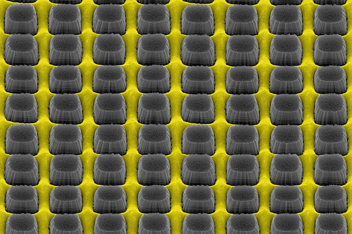 An array of nanopillars etched by thin layer of grate-patterned metal creates a nonreflective yet conductive surface that could improve electronic device performance