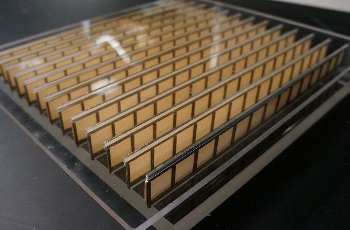 The metamaterial, shown here, is made of paper and aluminum -- but its structure allows it to manipulate acoustic waves in several ways