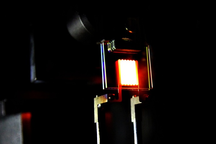 A proof-of-concept device built by MIT researchers demonstrates the principle of a two-stage process to make incandescent bulbs more efficient