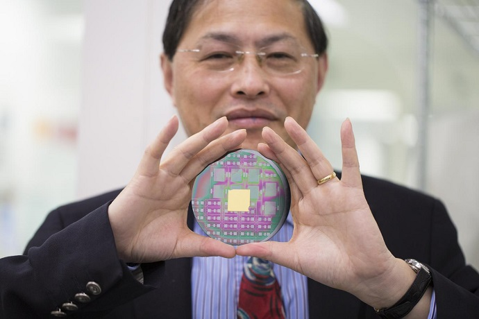 RMIT's Professor Min Gu with the breakthrough nanophotonic chip that can harness the angular momentum of light