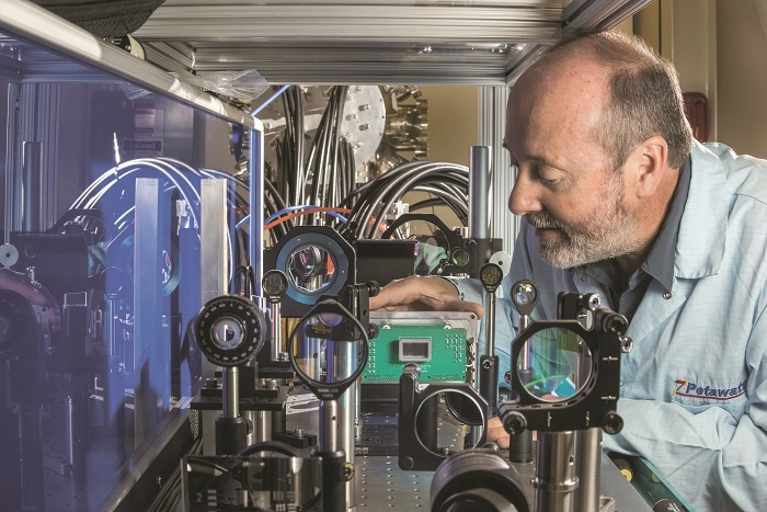 Sandia National Laboratories physicist John Porter carefully sets in place an ultrafast multiframe digital X-ray camera — the fastest in the world — in Sandia's Z-beamlet laser facility