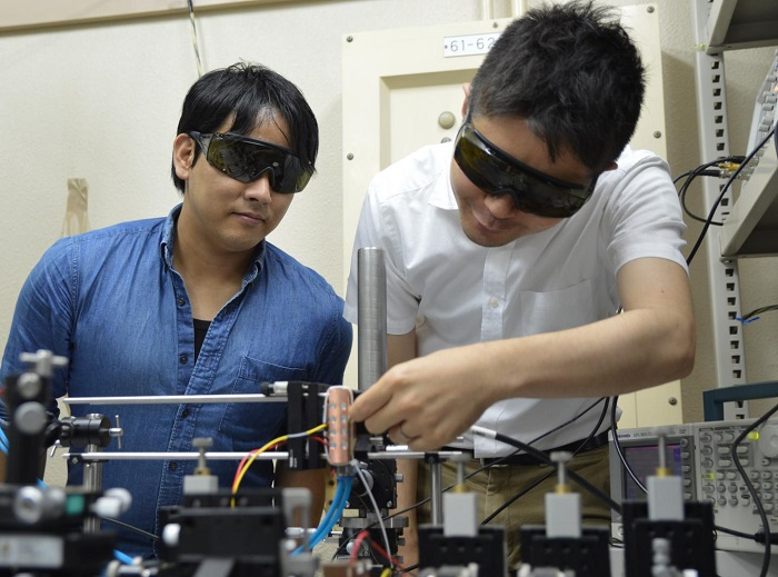This photo shows researchers working with the MO Q-switched laser
