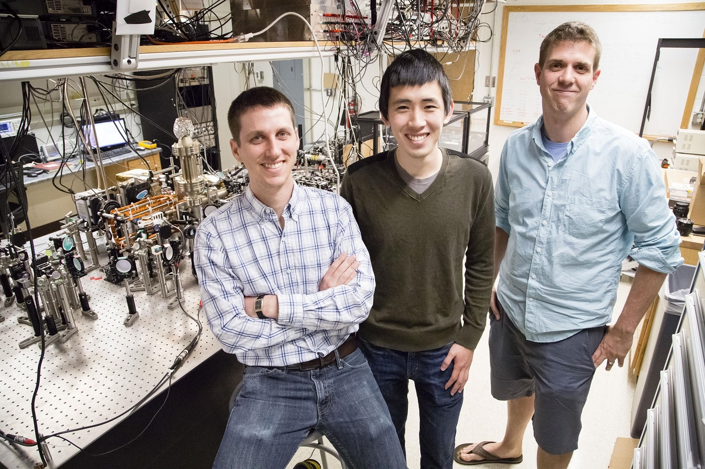 Graduate students Eric Meier and Fangzhao Alex An with Bryce Gadway in Loomis Laboratory