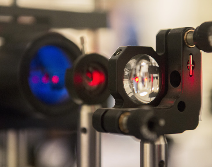 An infrared laser beam is going into the receiver of the signaling system