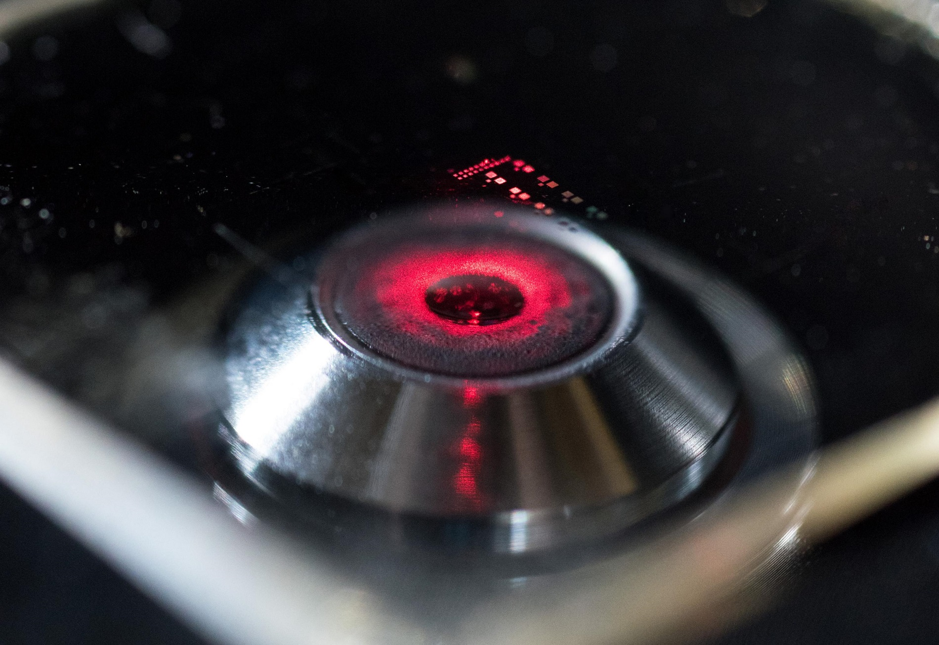 Laser light shows the nanopatterned structure of a chiral metamaterial developed by researchers in the School of Electrical and Computer Engineering at the Georgia Institute of Technology