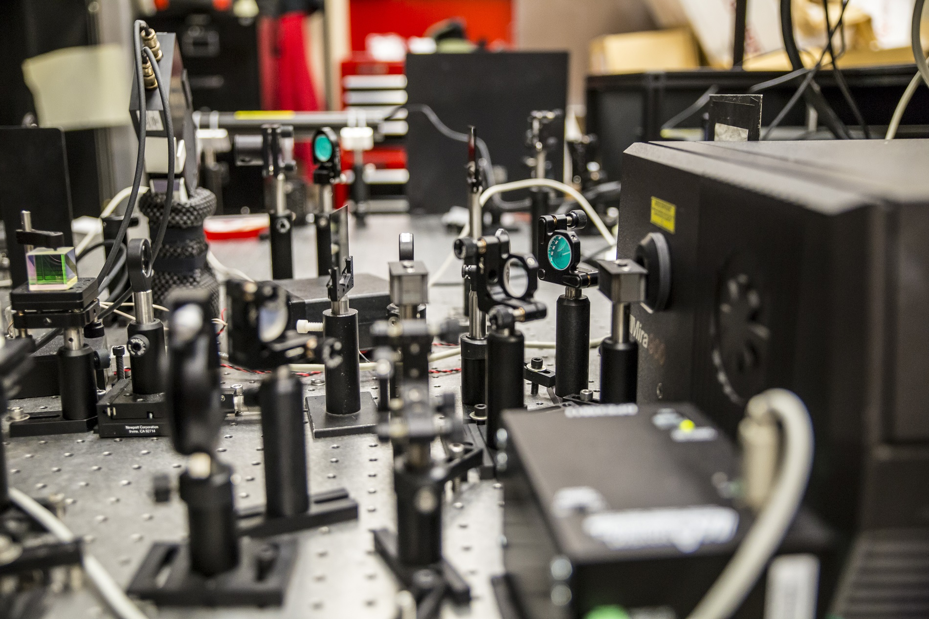 The ultrafast laser shoots very short light pulses 80 million times a second at the hybrid perovskite material to determine whether its electrons could be used to carry information in future devices