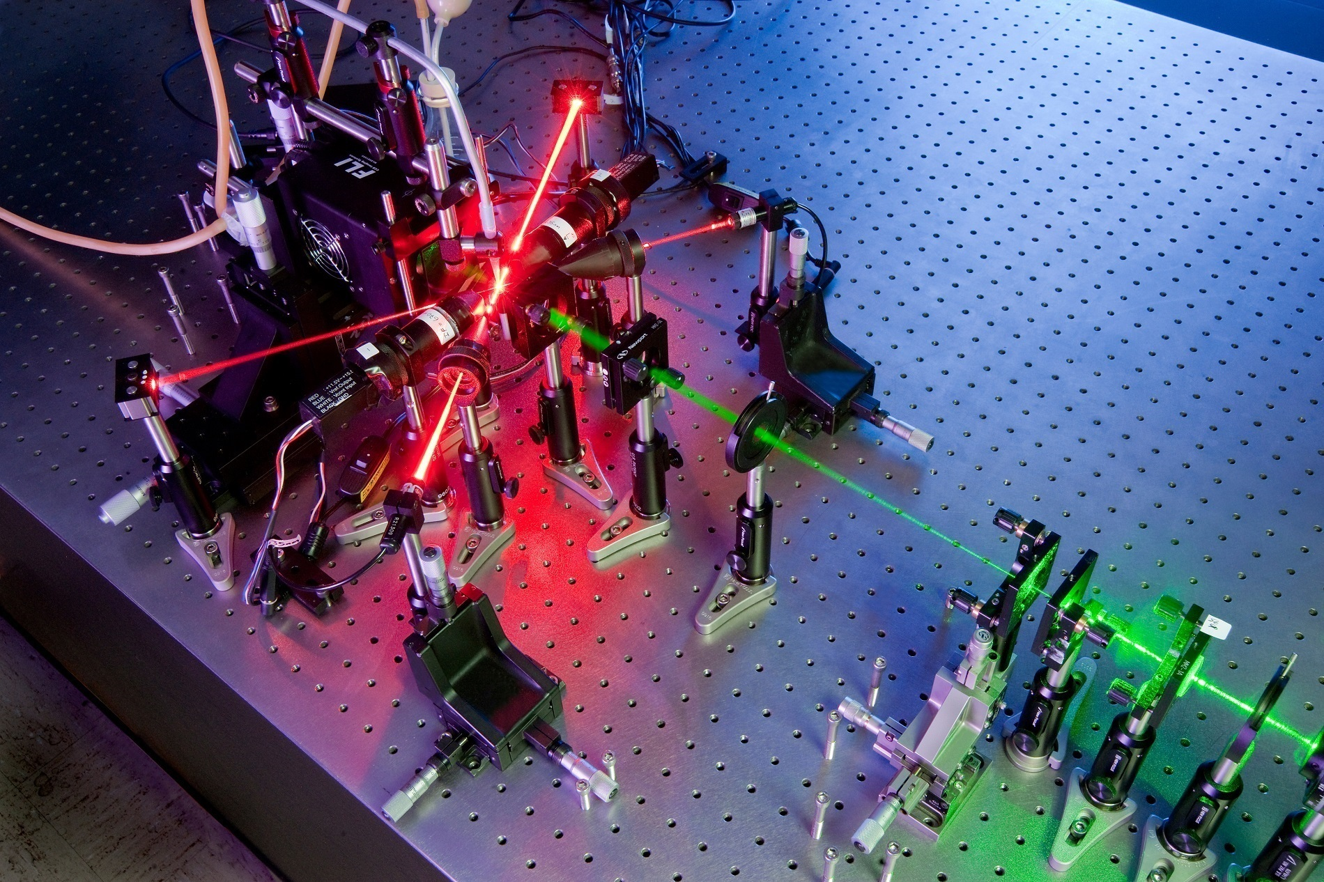 Two overlapping lasers are helping Kansas State University physics researchers create holographic images of free-flowing air particles, which may help climate scientists and biological weapons watchdogs monitor what's in the air.