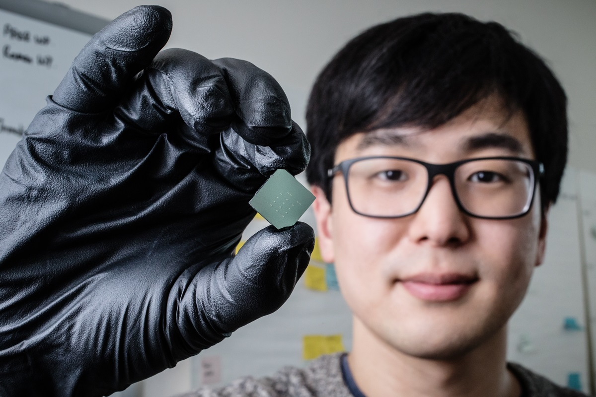 Illinois mechanical science and engineering student and lead author of a new study Benjamin Sohn holds a device that uses sound waves to produce optical diodes tiny enough to fit onto a computer chip