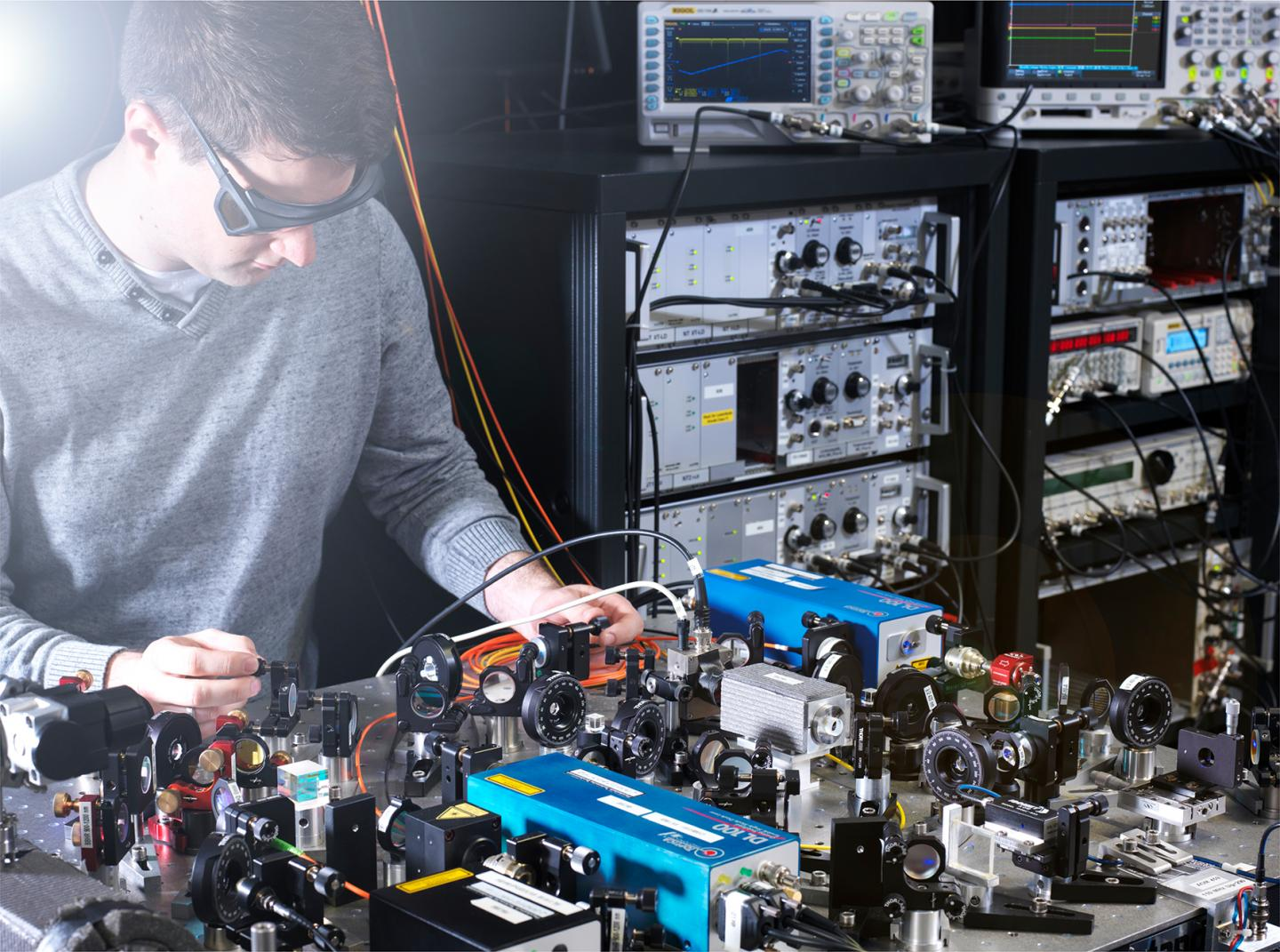 PTB scientist Johannes Thielking with the laser setup for measurements of the thorium-229 nuclear properties